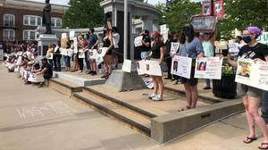 The 3/20 Coalition protests against police violence at the Centre County Government building.