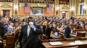The House held its first remote session Tuesday, with members who aren't in leadership allowed to vote by text or email. Still, approximately one third of members came to the Capitol.