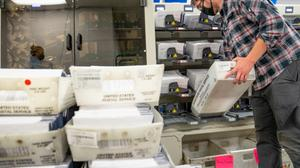 A worker organizes mail ballots in Chester County. Pennsylvania counties have been flooded with mail ballot requests, and the days-long process of counting them can't begin until Election Day under current state law.