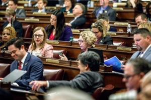 The state House on Monday passed temporary rules allowing members to vote remotely to party leaders, though those leaders will still be required to appear in person in the Capitol to formally consider legislation.