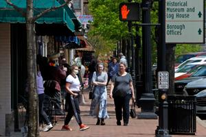 """People gather outside a Starbucks in Beaver, Pa. Beaver County Commissioners have said they disagree with Gov. Tom Wolf and the county will act as if they are transitioning to the """"yellow"""" phase on May 15."""