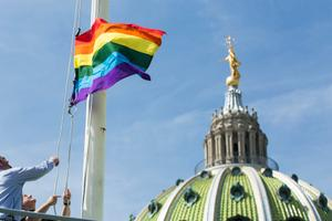 The LGBT flag flies at the Capitol building in Harrisburg.