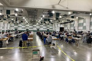 About 100 York County employees open and prepare mail ballots for counting after 8 p.m. Tuesday.