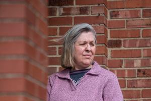 Sandy Kolenda outside her home in Munhall. She's among thousands of victims of identify fraud through Pennsylvania's unemployment system who was surprised with a tax bill for payments she did not receive.