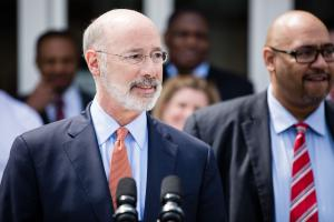 Gov. Tom Wolf (left) signed an order that directed the Department of Corrections, led by Secretary John Wetzel (right), to create a reprieve program for medically vulnerable inmates convicted of nonviolent crimes.