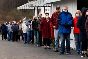 Voters stand in a line that kept growing in Jackson Township with a wait time of over an hour or more to voteat the Jackson Township Volunteer Fire House    FRED ADAMS/For the Inquirer 11-3-2020