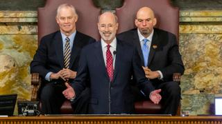 Pennsylvania Gov. Tom Wolf delivers his 2020-21 budget address in the state House of Representatives as Speaker Mike Turzai, left, and Lt. Gov. John Fetterman, right, look on, on Feb. 4, 2020, in Harrisburg, Pa