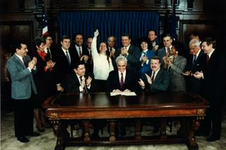 Deb Beck (center back) celebrates as Gov. Bob Casey Sr. (center front) signed Act 152 into law in 1988. The law required public insurance to cover drug and alcohol addiction treatment, an expansion of a previous law championed by Beck.
