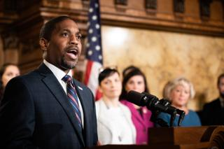 Micah Sims, executive director of Common Cause Pennsylvania, speaks at the Capitol during the signing of an election reform bill on Oct. 31, 2019. The group, which helped champion the state's 2006 lobbying law, was fined $19,900 for breaking it. Sims attributed the failure to technical difficulties.