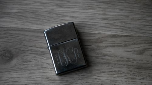 A lighter engraved with Adam Kalinowski's initials as photographed Wednesday, March 3, 2021.