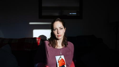 Amanda Pschirer sits for a portrait holding one of her favorite photos of her and brother, James Pschirer, at her home in McCandless on Thursday, Feb. 25, 2021.