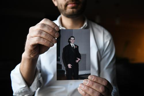 Ian Kalinowski holds a photo of his brother, Adam Kalinowski, on Wednesday, March 3, 2021. Adam died by suicide in 2014 while he was a client at a treatment center run by Addiction Specialists, Inc., in Fayette County, Pennsylvania.