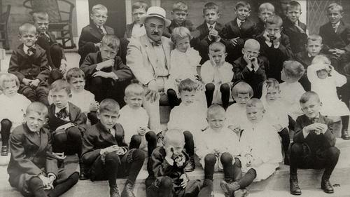 Milton Hershey pictured with students in 1913