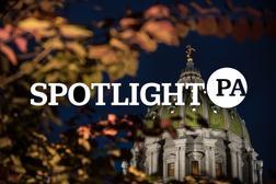 The Spotlight PA logo over the Pennsylvania state capitol