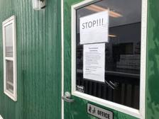 """On March 25, signs at a distribution center for Wolf Home Products in York County described it as an """"Essential Business"""" and listed social distancing steps."""