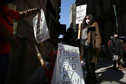 """Michelle Perry of Philadelphia protested outside Gov. Tom Wolf's Center City office earlier this month, demanding """"a working unemployment system to provide timely responses and benefits to unemployed workers."""""""