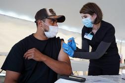 Giorgi Mushroom Company worker Juan Frutos gets a vaccine shot from Penn State Health nurse Christy Daniels during a clinic facilitated by Latino Connection's mobile unit. The Wolf administration hired the group this spring to address persistent disparities.