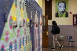 In this file photo, a student walks into a classroom at Jay Cooke Elementary in North Philadelphia. Philadelphia is among the school districts most shortchanged by the way Pennsylvania funds public education, according to a new analysis in a lawsuit challenging the system.