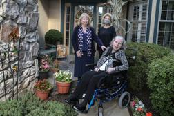 Christi Marshall, left with her sisters Karen Greene, center and sister Laura Hervey at Hershey's Mill in West Chester. Laura depends on her sisters in the event of a pipeline problem for her evacuation, Thursday, October 8, 2020