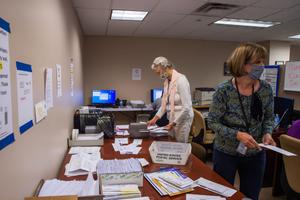 """Erie County employees are seen here organizing mail ballots during the 2020 presidential election. """"We would have had to go to county taxpayers several times without this,"""" Erie County Executive Director Kathy Dahlkemper wrote of the grant money."""
