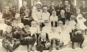 Milton Hershey and the early students of the school that bears his name in 1913.