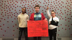 From left, Marshall Everett, Ed Peters, and Sabrina Herb protest the cuts to campus mental health services at HACC, Central Pennsylvania's Community College, on Oct. 23, 2019.