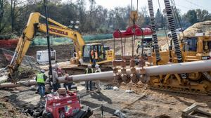 Pipefitters, left, work to connect a long segment of pipe that is being suspended in air to make it ready to be pulled undergroud in a residential area of West Chester, PA on Ship Road and South Pullman Drive as part of the Mariner East Pipeline that is going through the area on November 11, 2019.