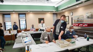 Volunteers opened and sorted mail-in ballots while poll watchers observed in Erie County on Nov. 3. The Erie County Board of Elections unanimously voted to certify its election results Thursday without any fanfare.