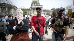Protesters and militia gathered outside the Capitol in Harrisburg this April for a reopen protest. A recent report by a worldwide nonprofit that tracks militia groups said Pennsylvania is one of five U.S. states at high risk of violence through Nov. 3.