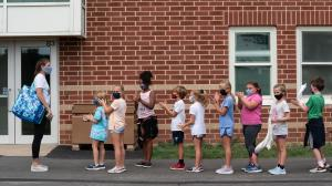 Students line up after recess for their third grade teacher Ms. Melissa Russo, far left, at Lower Gwynedd Elementary School in Ambler, PA, Thursday, September 3, 2020. The school's outdoor policy is that masks are worn outdoors if the person is within 6 feet of another person outdoors. Masks are required at all times indoors. JESSICA GRIFFIN  / Staff Photographer