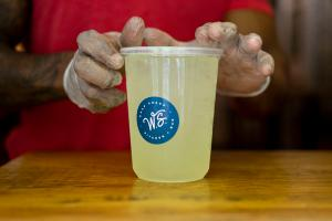 Kendrick Worth, manager at Wrap Shack in Philadelphia, creates a to-go margarita in May. Takeout cocktails are no longer allowed in the state.