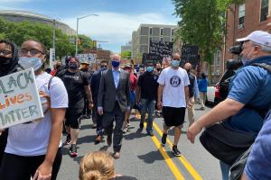 Gov. Tom Wolf marches with demonstrators in Harrisburg on June 3, 2020.