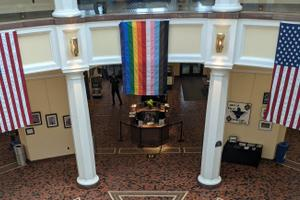 A Pride flag is currently hanging inside the Capitol's East Wing Rotunda as part of a permitted display requested by the Commission on LGBTQ Affairs' executive director.
