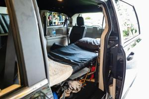 """Luke Shultz's chronic pain left him unable to drive, so his family set up a cot in the back of a minivan so he could lie down while someone else drove. He says cannabis has transformed his life: """"I don't have the science to back it up. I typically go by anecdotal evidence — myself included — that basically for real people it's had real, positive effects."""""""