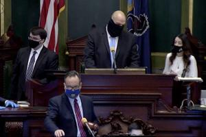 Lt. Gov. John Fetterman (center) confers with Senate Secretary Megan Martin (right), as Sen. Jake Corman (front, center), takes over the session to conduct a vote to remove Fetterman from residing over the session in Harrisburg on Tuesday, Jan. 5, 2021. Bobby Maggio, Fetterman's chief of staff, stands to the left.