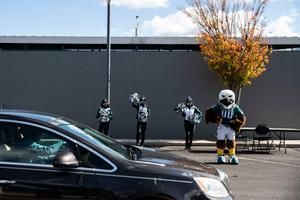 The Eagles mascot, Swoop, and team cheerleaders greeted voters dropping off their mail ballots at a satellite election office site at Lincoln Financial Field in Philadelphia on Nov. 2, 2020.