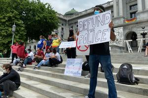 Kevin Buschan holds a sign at a demonstration demanding justice for George Floyd in Harrisburg on June 3, 2020.