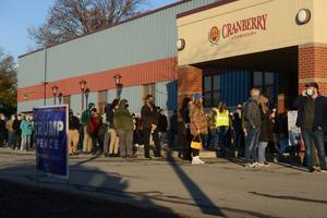 Voters line up outside the Cranberry Municipal Center in Cranberry Township, Butler County, in the first hour of voting on Election Day 2020.
