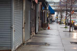 A man standing on the sidewalk on 52nd Street is surrounded by local business's that are closed due to the coronavirus outbreak on Saturday, March, 28, 2020.