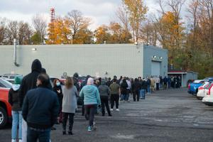 """Voters stand in line at Belle Valley Fire Department in Erie County waiting to vote in-person on Nov. 3. A post-election report from Erie County's clerk said there were """"significant instances where judges of elections lacked understanding about the basic operation of the polling place."""""""