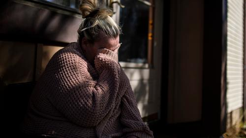 Laura Gallagher, of Langhorne, Pa., tears up in front of her home due to the fear of being evicted with nowhere to go on Wednesday, Oct. 14, 2020.