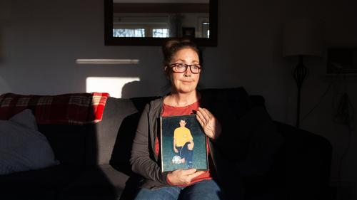 Andrea Zack sits for a portrait with a picture of her son, James Pschirer, at her home in McCandless, Pennsylvania on Thursday, Feb. 25, 2021.