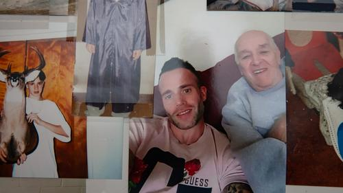 A memory board features photos of James Pschirer's life, including this one of him and his stepfather, Ron Zack.