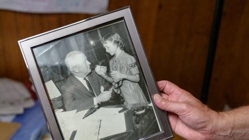 """A frame is held showing a picture of Alice """"Candy"""" Loughney as a young girl with her father, Joseph M. Barr."""