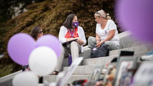 Susan Ousterman speaks to the Department of Drug and Alcohol Programs secretary, Jennifer Smith, during an overdose awareness event at the state Capitol in Harrisburg on Aug. 31, 2021.